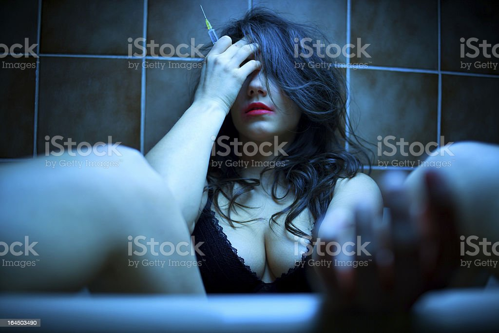 Woman shooting heroin royalty-free stock photo