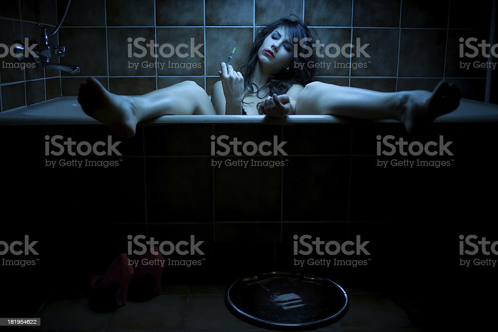 Woman shooting heroin royalty-free stock photo