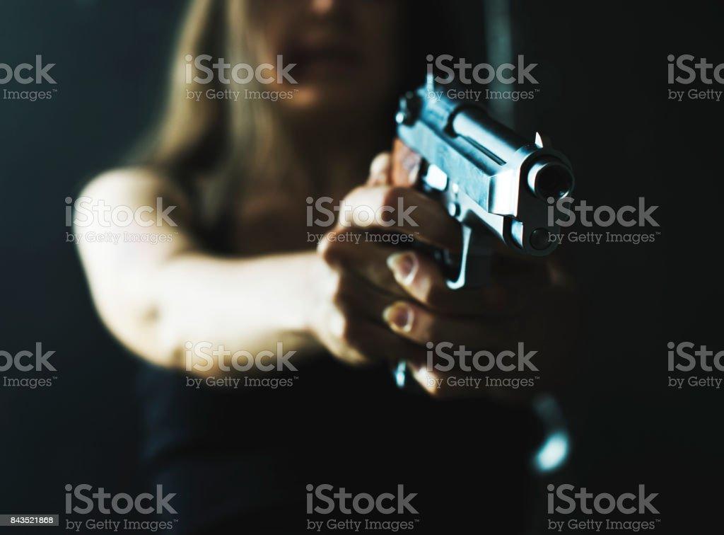 Woman shooting weapon
