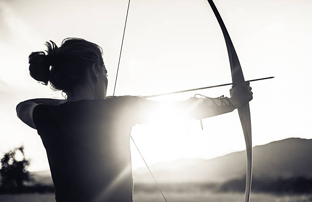 woman shooting with the longbow - arrow bow and arrow stock pictures, royalty-free photos & images