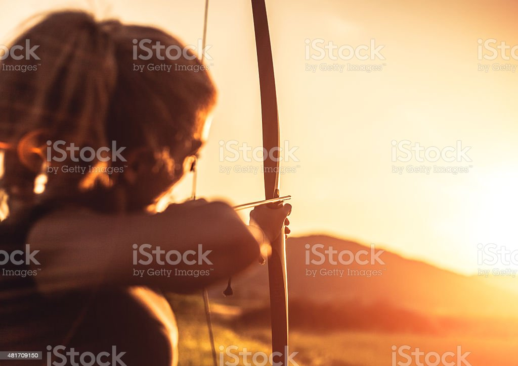 Woman shooting with the longbow stock photo