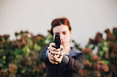 Woman shoots out of a pistol