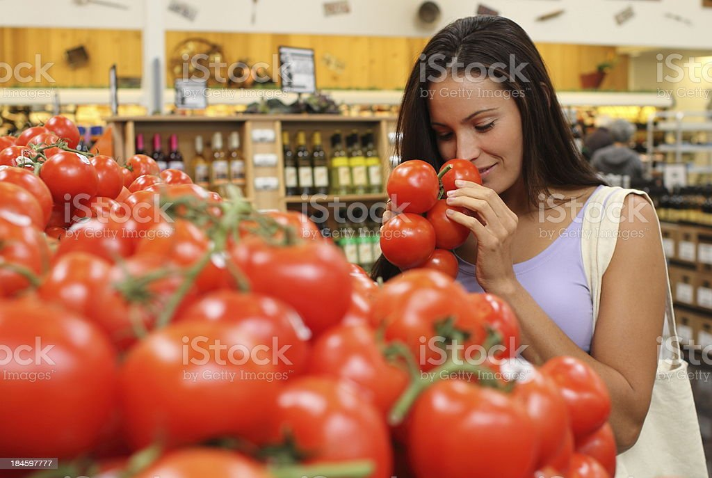 Woman Shopper Checks Tomatoes royalty-free stock photo