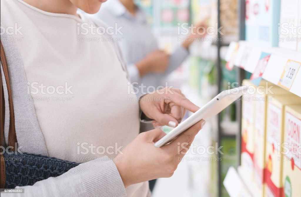 Woman shopping and using a tablet stock photo