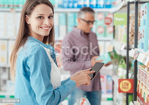 istock Woman shopping and using her phone 670324578