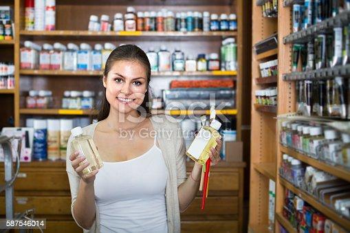 594918592 istock photo woman shopping art supplies 587546014