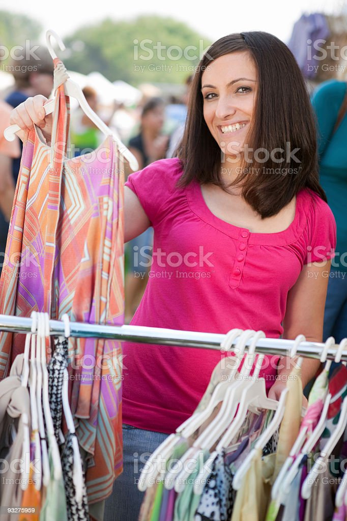 Woman shopping at a craft show royalty-free stock photo