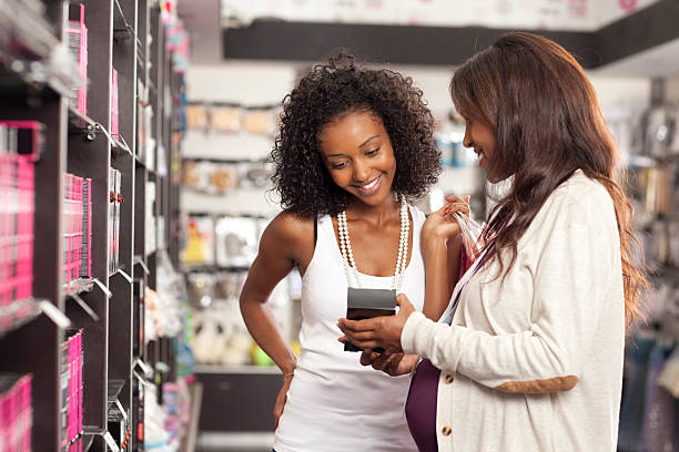 woman shopping at beauty store. - makeup for pregnant women stock photos and pictures