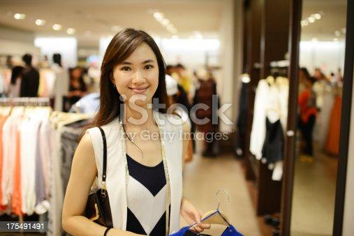 istock Woman Shopping At Clothing Store - XXXXXLarge 175491491
