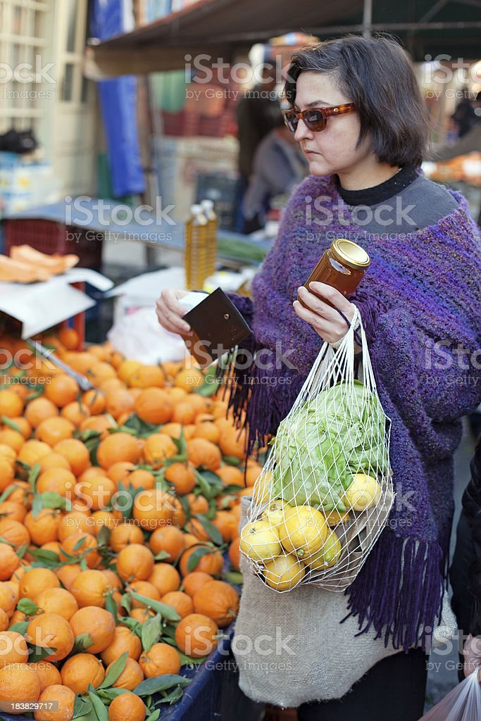Woman shopping at the farmers market royalty-free stock photo