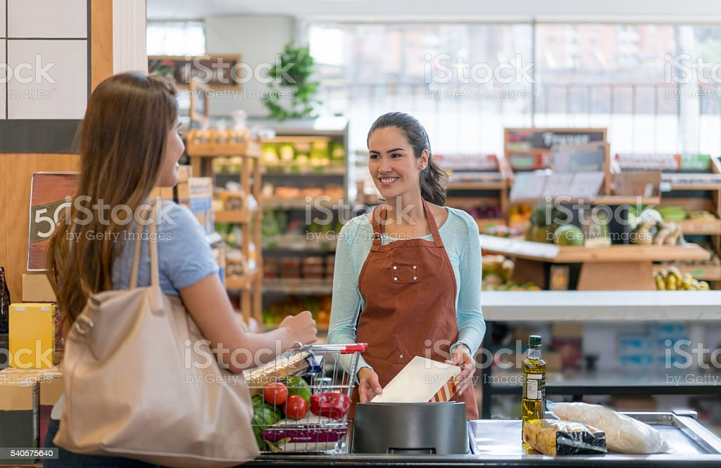 Woman shopping at the supermarket stock photo