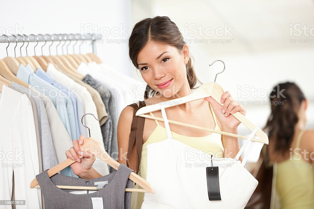 Woman shopping buying clothes stock photo