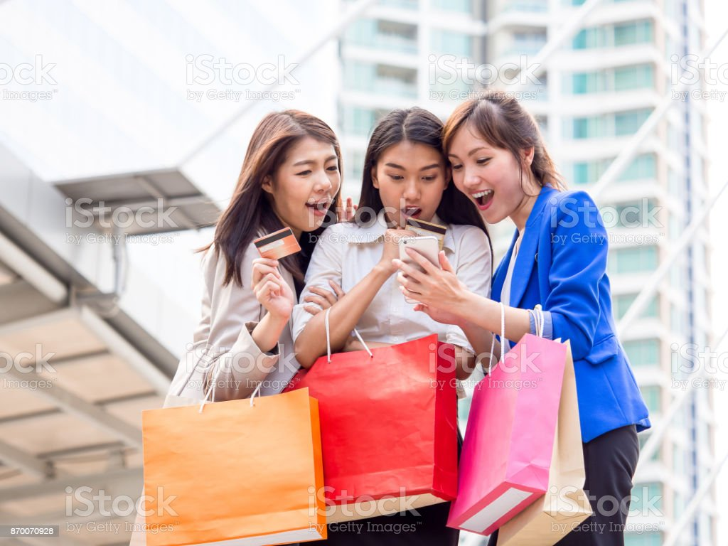 Woman shopping concept, asian woman holding colorful shopping bags...
