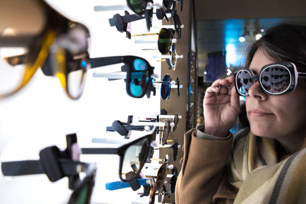 Woman Shopping Eyeglasses in Commercial Store stock photo