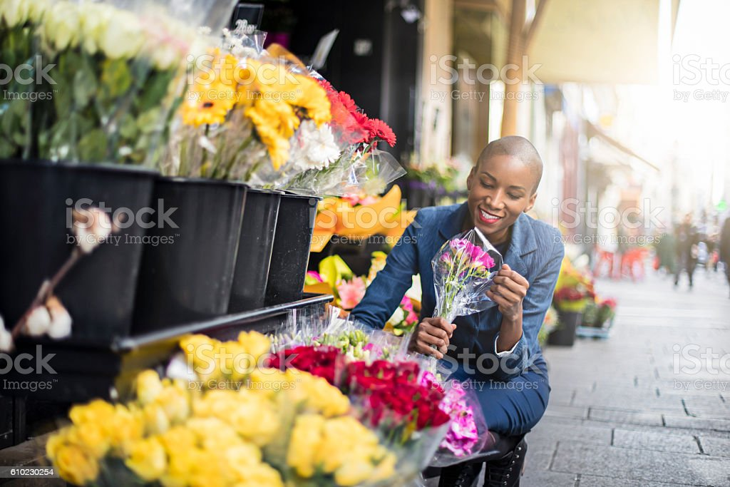 Woman shopping flowers in the streets of Paris stock photo