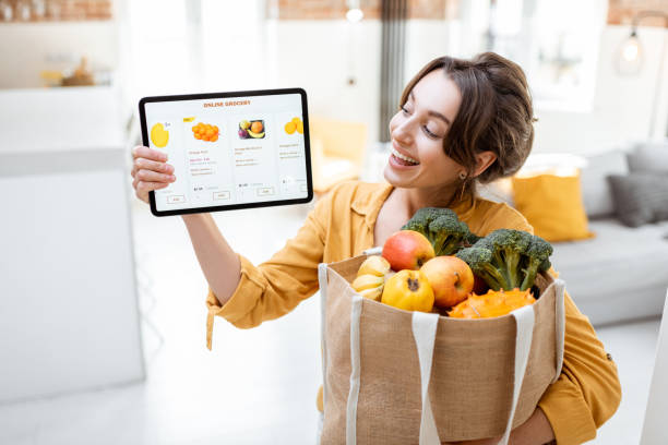 Woman shopping food online stock photo