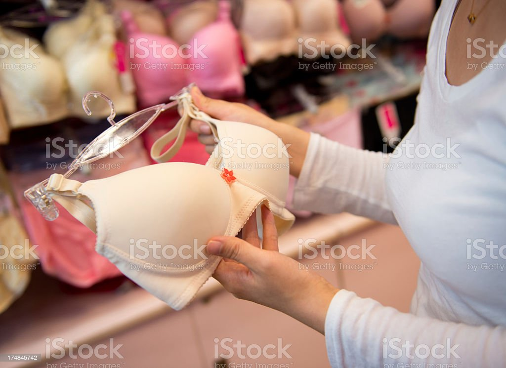 Woman shopping for a white bra stock photo