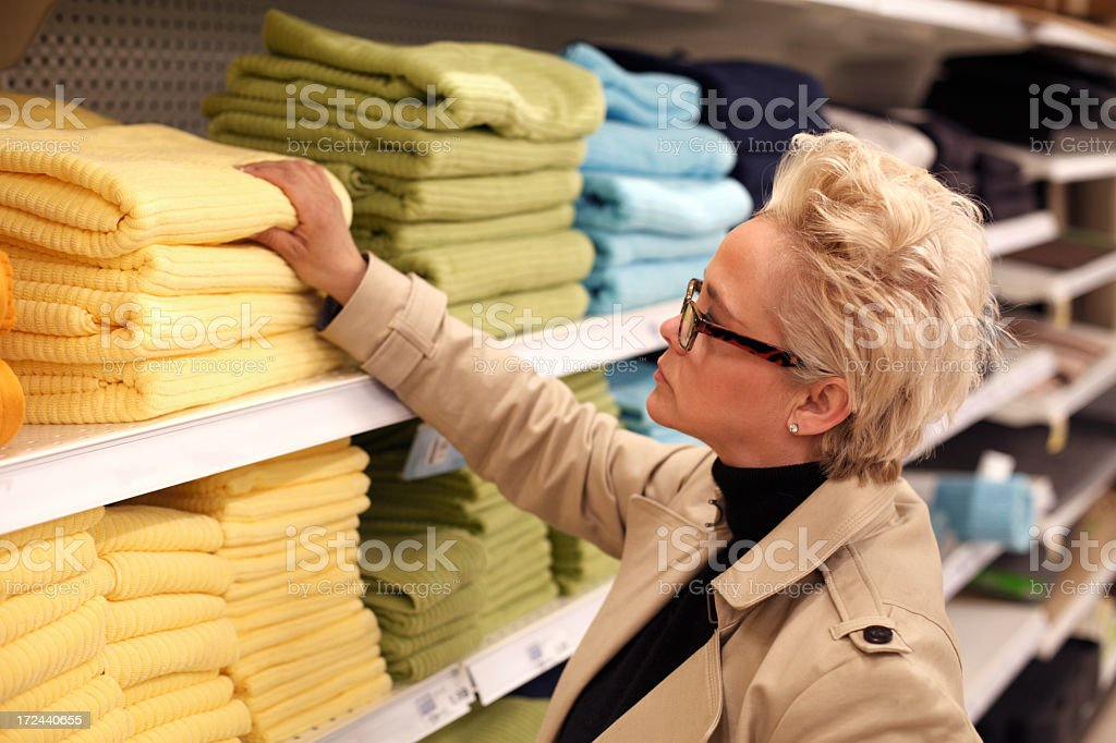 Woman shopping for bathroom towels royalty-free stock photo