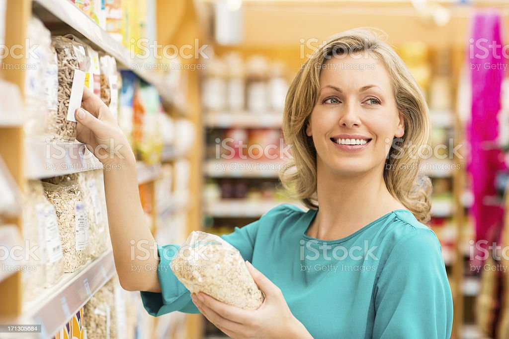 Woman shopping For Cereals In Supermarket royalty-free stock photo