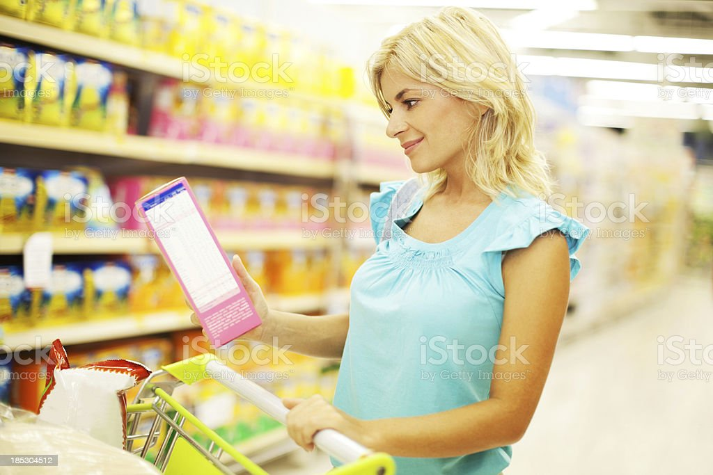 Woman shopping for cereals royalty-free stock photo
