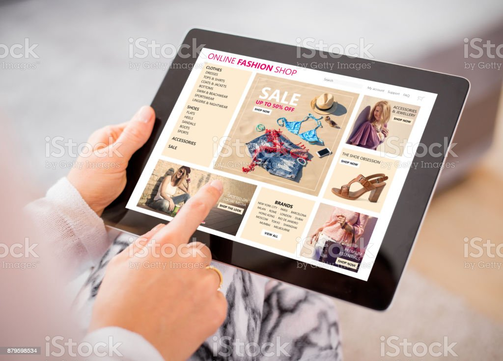 Woman shopping for clothes online. stock photo