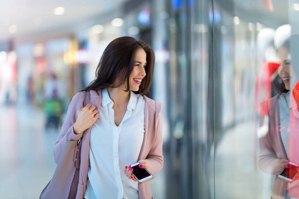 Woman shopping for clothes stock photo