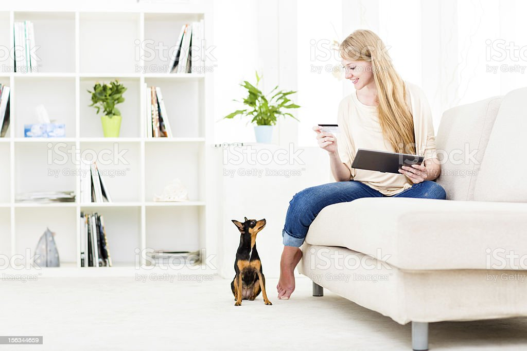 Woman shopping for dog's food royalty-free stock photo