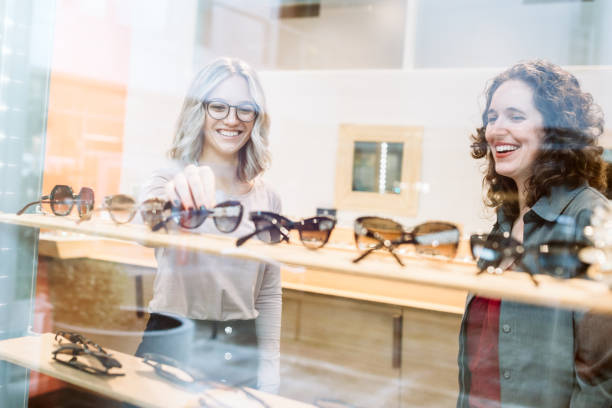 woman shopping for glasses - optometrist stock pictures, royalty-free photos & images