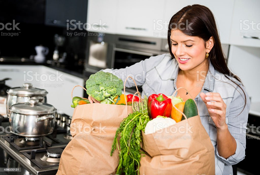 Woman shopping for groceries stock photo