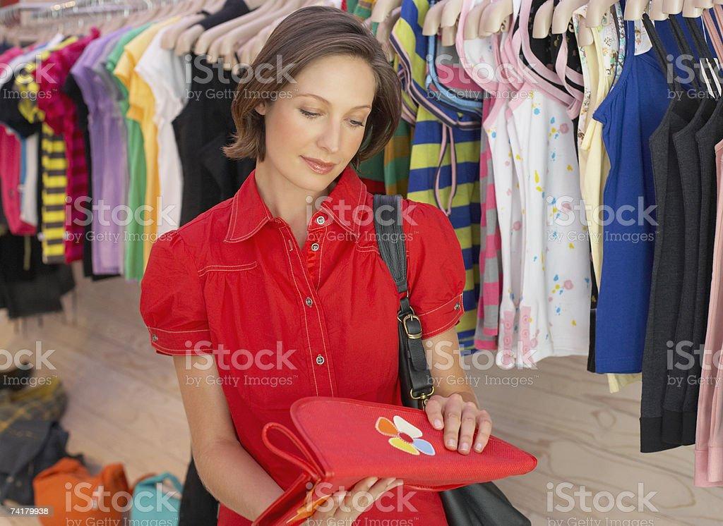 Woman shopping for handbag royalty-free stock photo