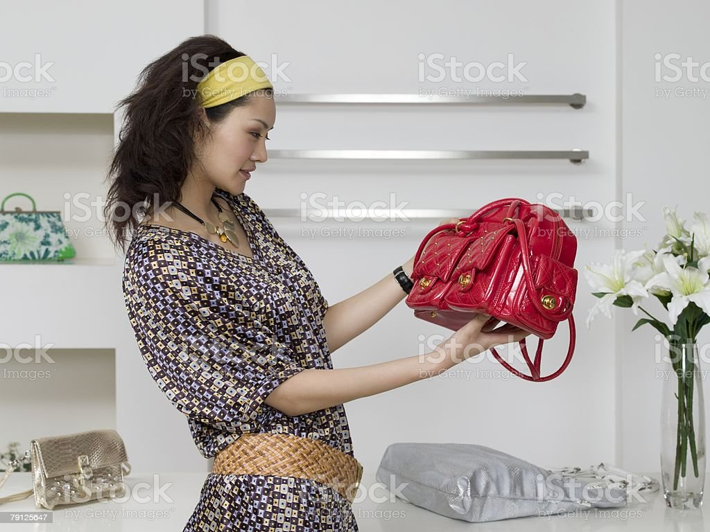 Woman shopping for handbags 免版稅 stock photo