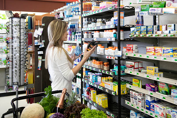 woman shopping for health and beauty supplies - vitamin stock pictures, royalty-free photos & images