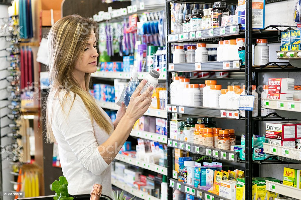 Woman shopping for health and beauty supplies stock photo