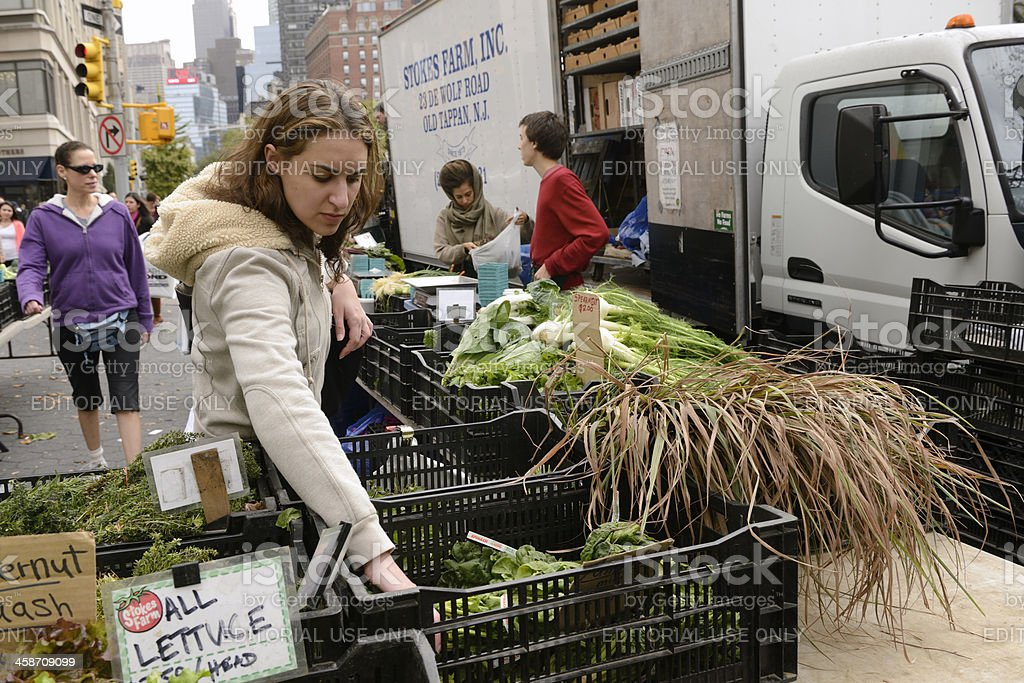 Woman Shopping for Healthy Food at Urban Farmer's Market stock photo