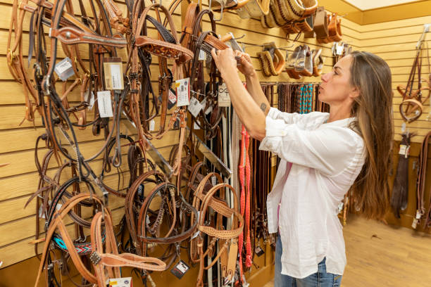 Woman shopping for horse equipment in a saddlery shop picture id1053676366?b=1&k=6&m=1053676366&s=612x612&w=0&h=vxgimn1iae6csqgrzsuj7h8o lfnrgk4cqchxo4ywbi=