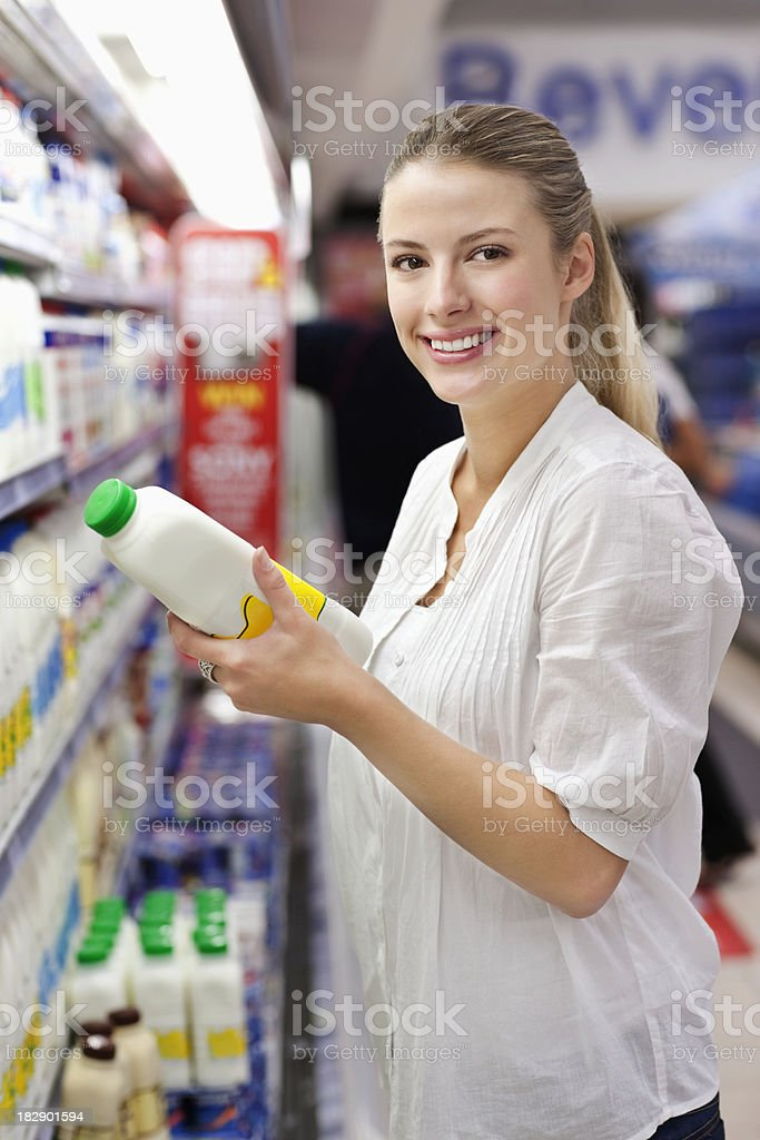 Woman Shopping for Milk royalty-free stock photo