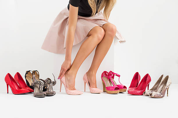 woman shopping for new shoes - shoe stock photos and pictures