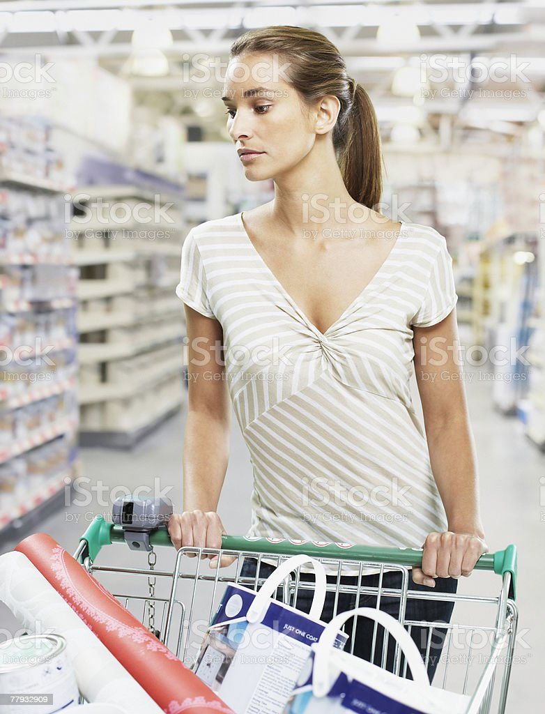 Woman shopping for paint and wallpaper 免版稅 stock photo