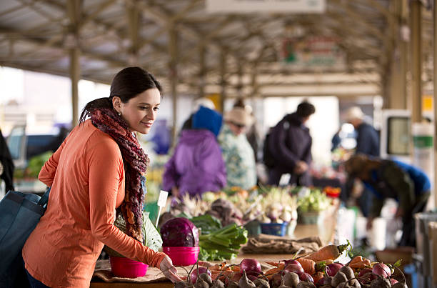 Woman Shopping for Produce at a Midwest Farmers Market. stock photo
