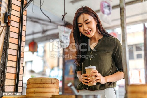 Beautiful woman shopping for steamer basket at street market