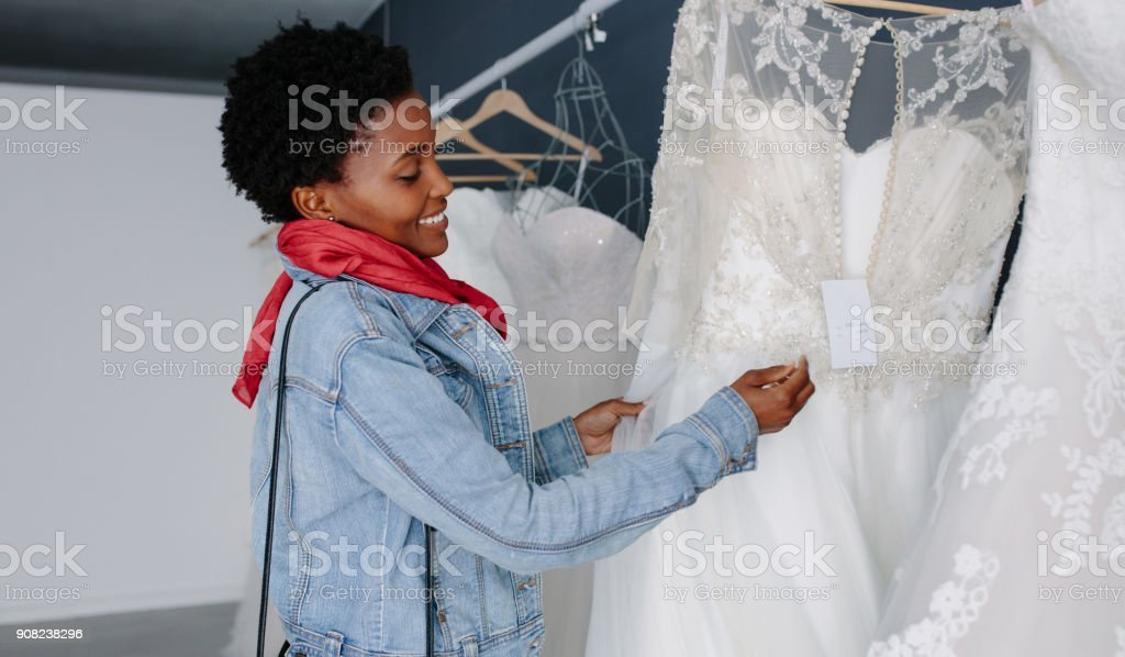 Woman shopping for wedding outfit in bridal boutique stock photo