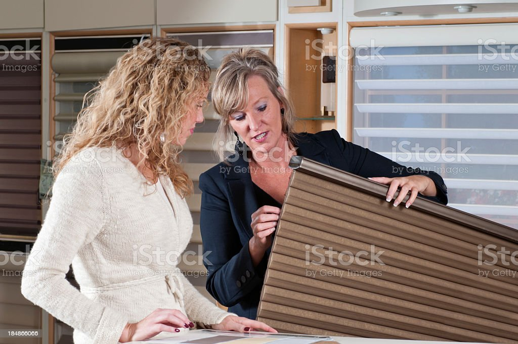 Woman Shopping for Window Shades stock photo