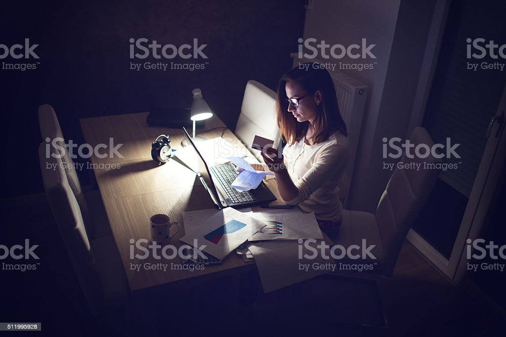 Woman shopping from home stock photo