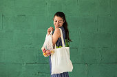 istock Woman shopping fruits and vegetables with reusable cotton Eco produce bag. Zero waste lifestyle concept 1170466795