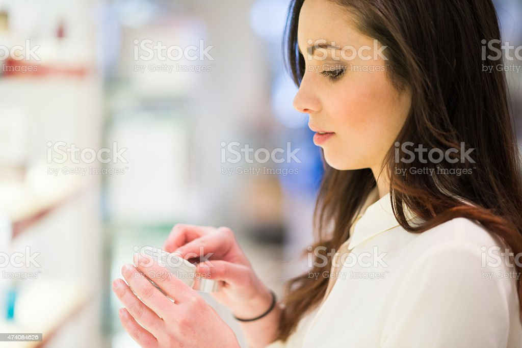 Woman shopping in a beauty shop stock photo