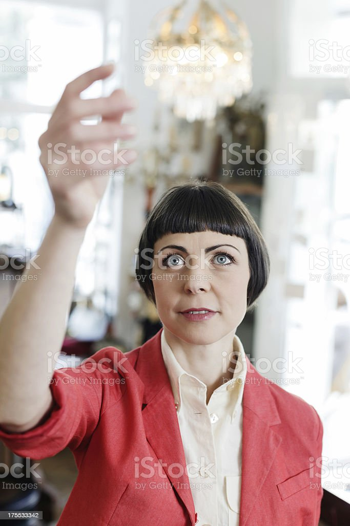 Woman Shopping in Antique Store stock photo