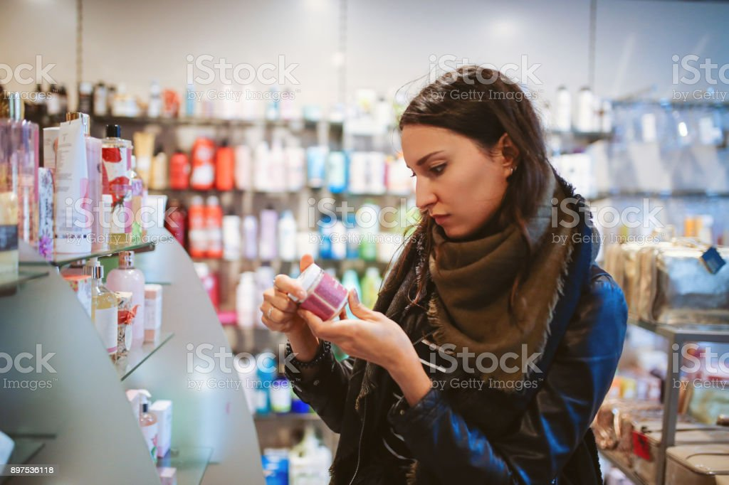 Woman shopping in cosmetics shop stock photo
