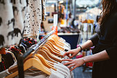 istock Woman shopping in East London second hand marketplace 881096270