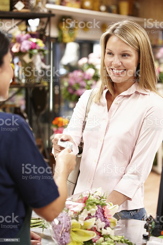 Woman shopping in florist royalty-free stock photo