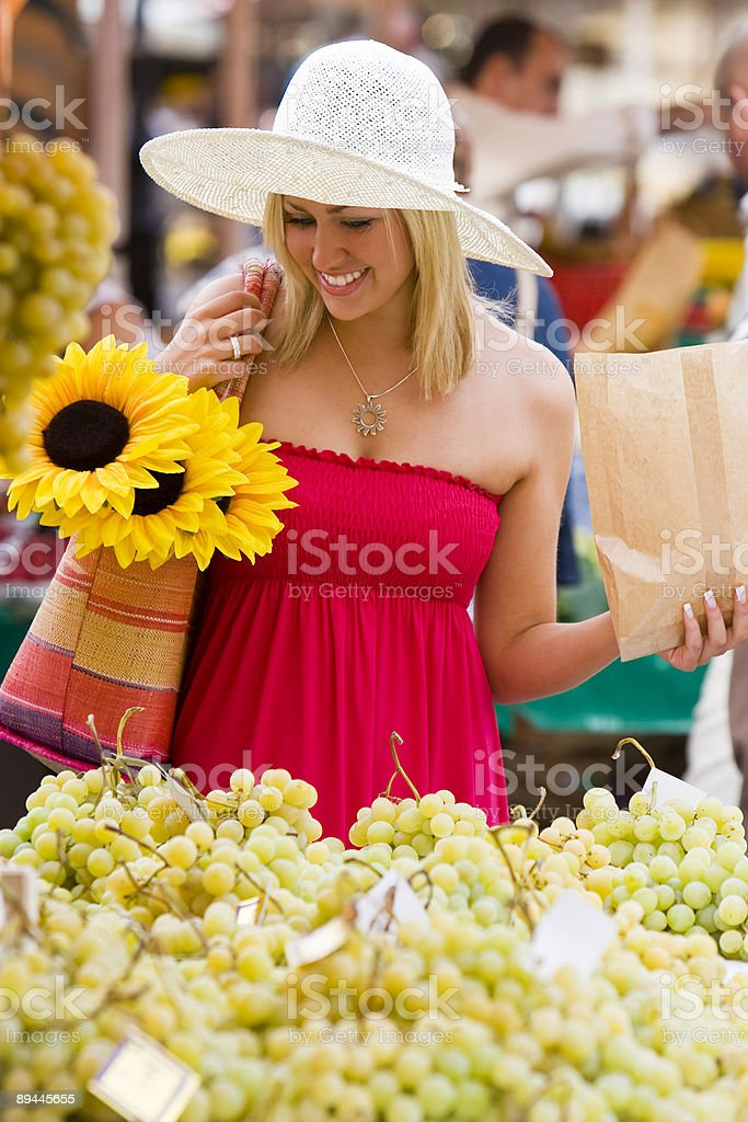 Woman Shopping In Fruit Market with Sunflowers royalty-free stock photo